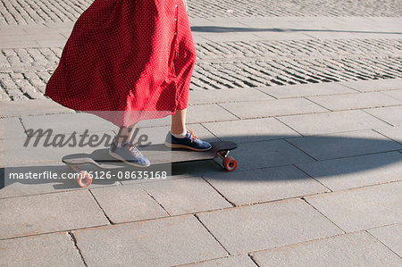 Sweden, Stockholm, Kungstradgarden, Teenage girl (16-17) on longboard Stock Photo - Premium Royalty-Free, Image code: 6126-08635168