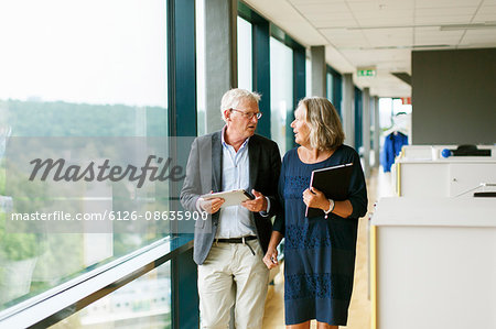 Sweden, Two business people having discussion while walking Stock Photo - Premium Royalty-Free, Image code: 6126-08635900