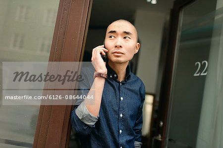 Sweden, Young man on the phone Stock Photo - Premium Royalty-Free, Image code: 6126-08644044