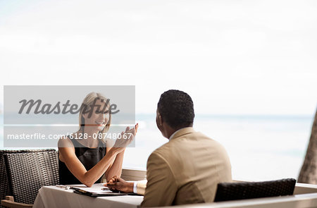 Businesswoman having meeting with her business partner on the balcony. Stock Photo - Premium Royalty-Free, Image code: 6128-08748067