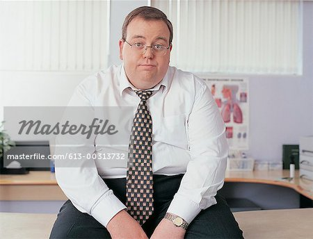 Portrait of an Overweight Businessman in a Doctor's Office Stock Photo - Premium Royalty-Free, Image code: 613-00313732