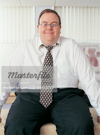 Portrait of Overweight, Smiling Businessman Stock Photo - Premium Royalty-Free, Image code: 613-00313733