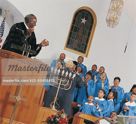 Gospel Choir Singing and Clapping During a Church Service Stock Photo - Premium Royalty-Free, Image code: 613-00455832