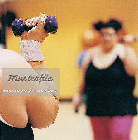 Close Up Detail of a Woman Doing Weight Training in a Gym Stock Photo - Premium Royalty-Free, Image code: 613-00533996