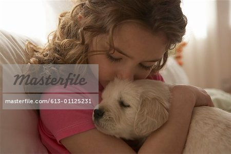 Girl (8-10) kissing dog Stock Photo - Premium Royalty-Free, Image code: 613-01125231