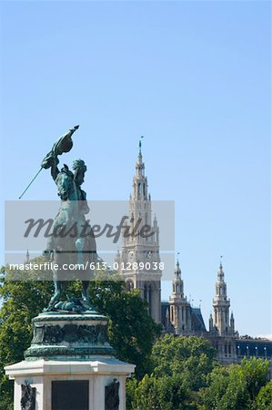 Austria, Vienna, Statue of archduke Karl, town hall in background Stock Photo - Premium Royalty-Free, Image code: 613-01289038