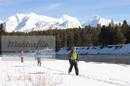 Three people cross country skiing Stock Photo - Premium Royalty-Free, Image code: 613-01388449