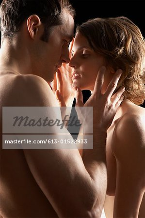 Naked couple embracing, side view Stock Photo - Premium Royalty-Free, Image code: 613-01522933