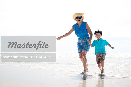 Grandmother and Grandson Running on the Beach Stock Photo - Premium Royalty-Free, Image code: 613-07454171
