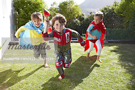 Boys playing together in a garden Stock Photo - Premium Royalty-Free, Image code: 613-07459159