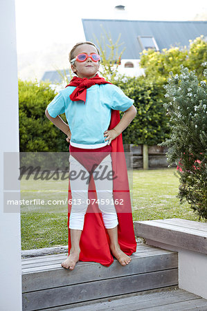 Boy pretending to be a super hero Stock Photo - Premium Royalty-Free, Image code: 613-07459162