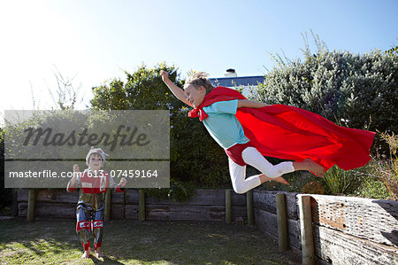 Boys playing at being superheroes Stock Photo - Premium Royalty-Free, Image code: 613-07459164
