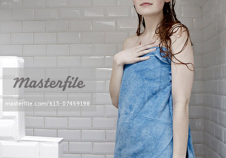 Portrait of woman wrapped in towel after a shower Stock Photo - Premium Royalty-Free, Image code: 613-07459198