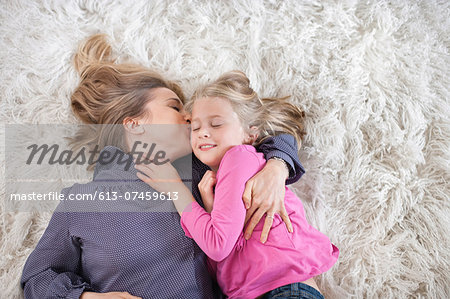 Mother kissing daughter Stock Photo - Premium Royalty-Free, Image code: 613-07459613