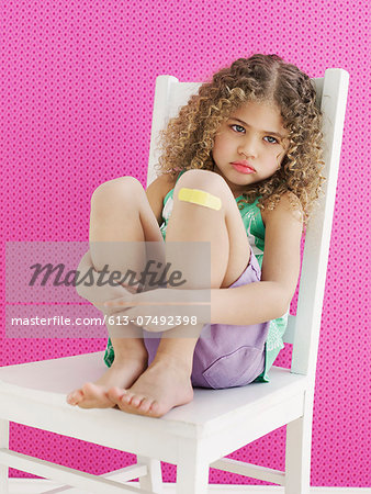 Girl with Band-aid Stock Photo - Premium Royalty-Free, Image code: 613-07492398