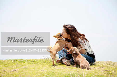 a woman with two dogs Stock Photo - Premium Royalty-Free, Image code: 613-07492533