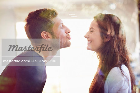 Young couple about to kiss Stock Photo - Premium Royalty-Free, Image code: 613-07492608