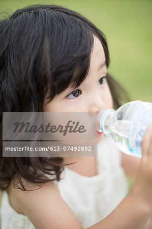 Japanese girl drinking water portrait Stock Photo - Premium Royalty-Free, Image code: 613-07492892