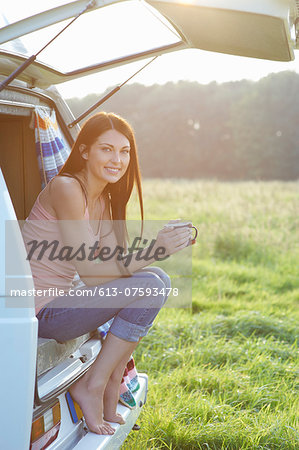 Woman sitting in camper van with hot drink. Stock Photo - Premium Royalty-Free, Image code: 613-07593478