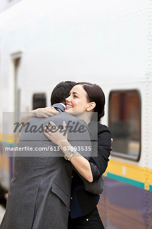 Couple embracing at train station Stock Photo - Premium Royalty-Free, Image code: 613-07593535