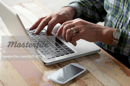 Senior Male with Technology Stock Photo - Premium Royalty-Free, Image code: 613-07596835