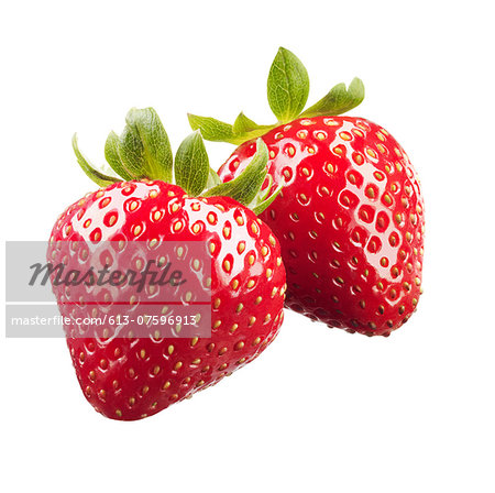 Strawberries on White Background Stock Photo - Premium Royalty-Free, Image code: 613-07596913