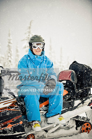 Man on snowmobile Stock Photo - Premium Royalty-Free, Image code: 613-07734663