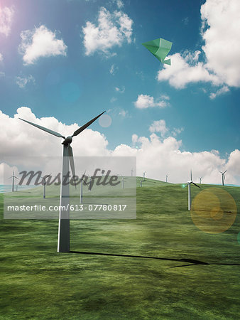 Paper airplane flying above the wind farms Stock Photo - Premium Royalty-Free, Image code: 613-07780817