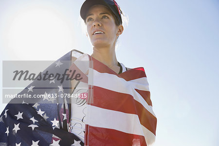 Female athlete wrapped in American flag Stock Photo - Premium Royalty-Free, Image code: 613-07848815