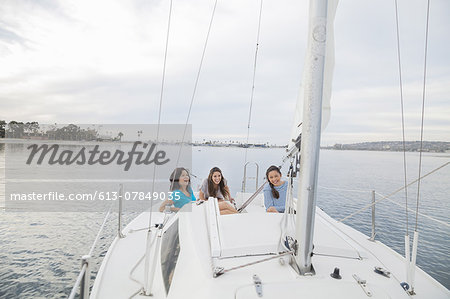 Mother and daughters having fun on sailboat Stock Photo - Premium Royalty-Free, Image code: 613-07849035
