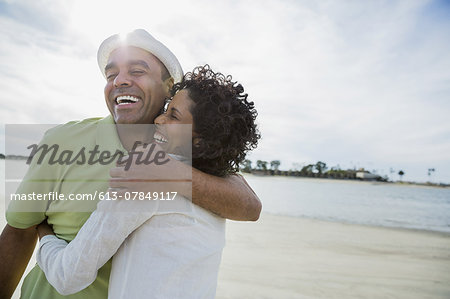Loving mature couple embracing on beach Stock Photo - Premium Royalty-Free, Image code: 613-07849117