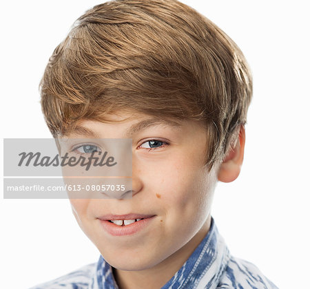 Close up portrait of smiling boy (12-14) Stock Photo - Premium Royalty-Free, Image code: 613-08057035