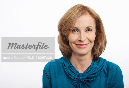Close up portrait of smiling woman Stock Photo - Premium Royalty-Free, Image code: 613-08057228