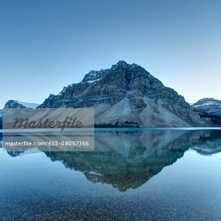 Reflection of mountains on tranquil lake surface Stock Photo - Premium Royalty-Free, Image code: 613-08057366