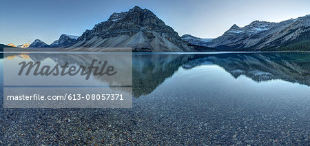 Reflection of mountains on tranquil lake surface Stock Photo - Premium Royalty-Free, Image code: 613-08057371