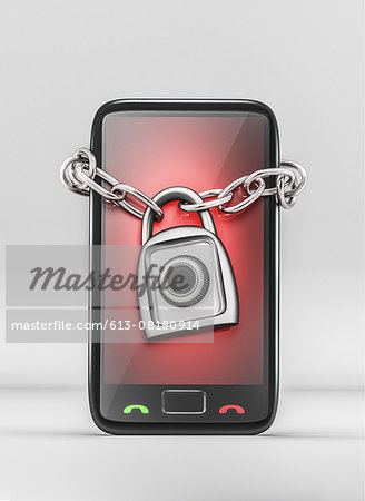Mobile phone wrapped with lock Stock Photo - Premium Royalty-Free, Image code: 613-08180914