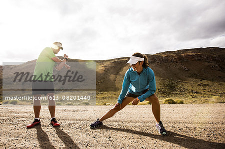 Couple stretching while running Stock Photo - Premium Royalty-Free, Image code: 613-08201440