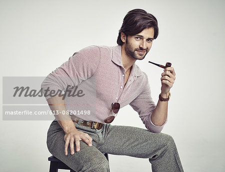 Digging his retro style Stock Photo - Premium Royalty-Free, Image code: 613-08201498