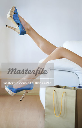 Taking a break from walking in heels Stock Photo - Premium Royalty-Free, Image code: 613-08233397