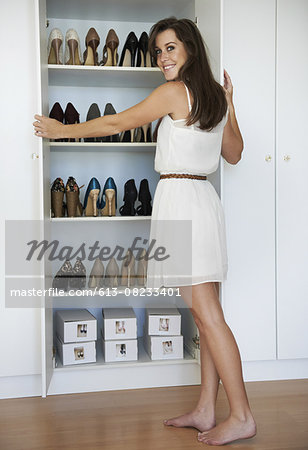 Avid shoe collector Stock Photo - Premium Royalty-Free, Image code: 613-08233401