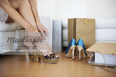 Fitting them on Stock Photo - Premium Royalty-Free, Image code: 613-08233408
