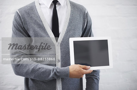 Copyspace on his tablet Stock Photo - Premium Royalty-Free, Image code: 613-08233860