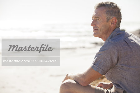 Mature man relaxing on beach Stock Photo - Premium Royalty-Free, Image code: 613-08242497