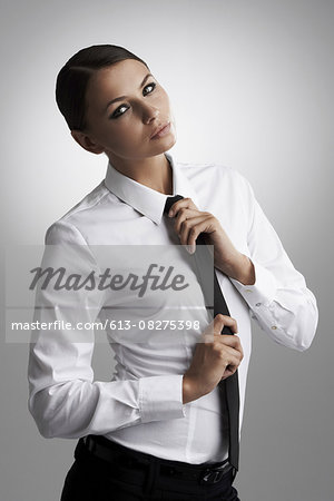 Straightening up her style Stock Photo - Premium Royalty-Free, Image code: 613-08275398
