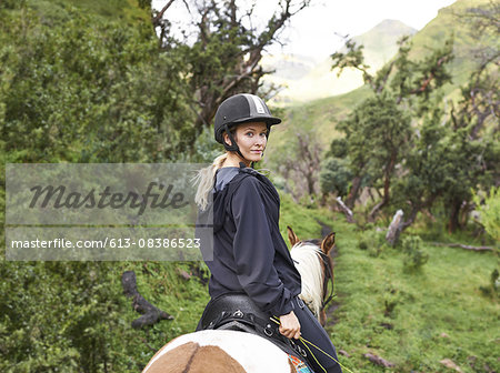 Ready to embark on a mountain trail via horseback Stock Photo - Premium Royalty-Free, Image code: 613-08386523