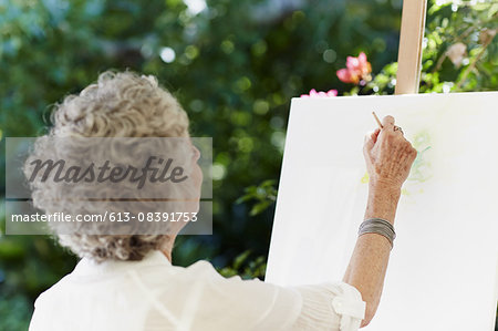 Senior woman painting on canvas Stock Photo - Premium Royalty-Free, Image code: 613-08391753