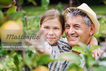 Grandfather And Granddaughter Harvesting Apples Stock Photo - Premium Royalty-Free, Image code: 613-08392224