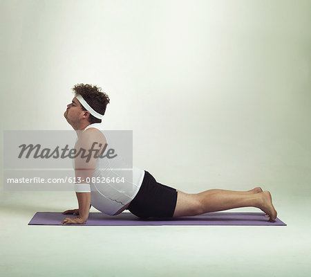 This upward facing dog pose is great Stock Photo - Premium Royalty-Free, Image code: 613-08526464