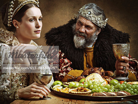 He's feasting and his goblet is full...again! Stock Photo - Premium Royalty-Free, Image code: 613-08557425