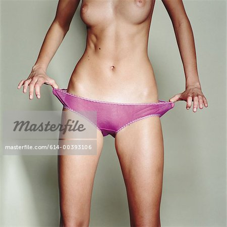 Female midriff Stock Photo - Premium Royalty-Free, Image code: 614-00393106